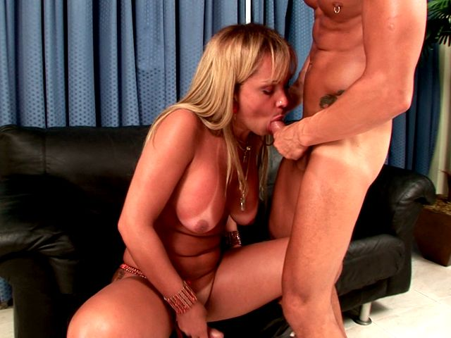 Blonde shemale with nice big tits giving head on the coach