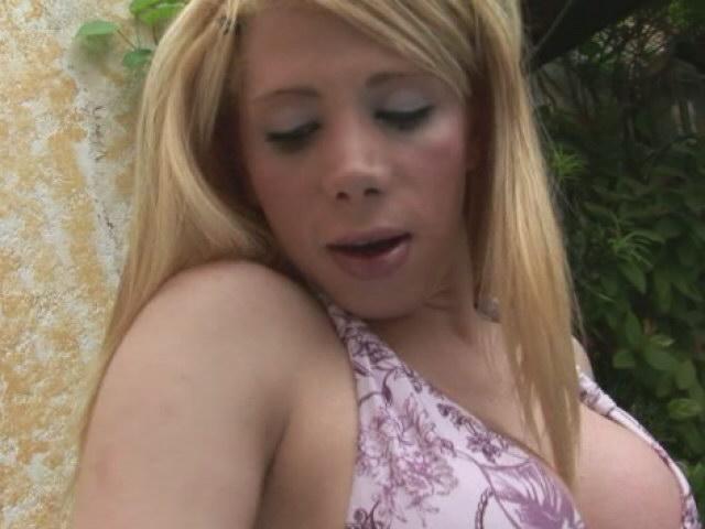 Beautiful blonde shemale in bikini Fabi Colt teasing outdoor