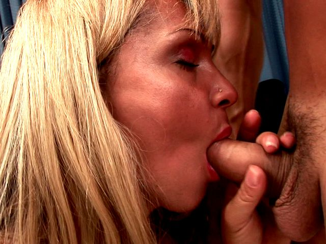 Seductive blonde tranny giving head to her friend